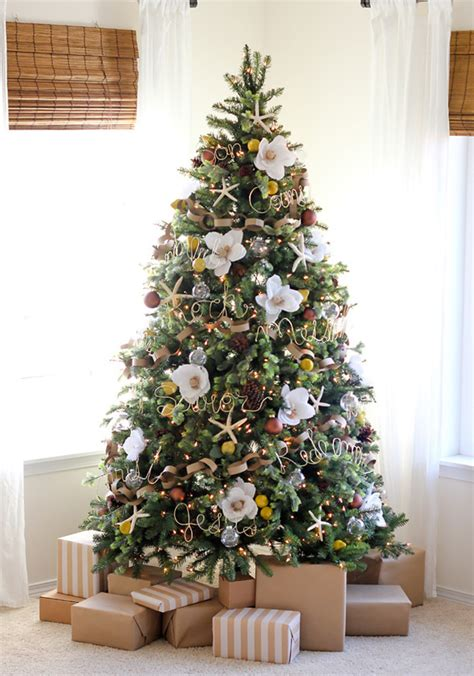 tree branch decor home design christmas decorations flowering diy she tucks a giant flower into her tree when the camera