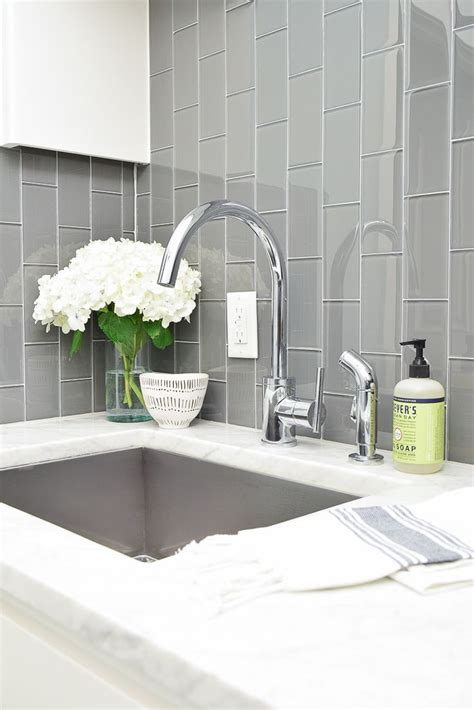 Pretty amp functional laundry room details room reveal laundry room sink gray subway tiles