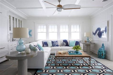 turquoise blue living room cottage living room decor natural linen skirted sofa with navy and turquoise fan