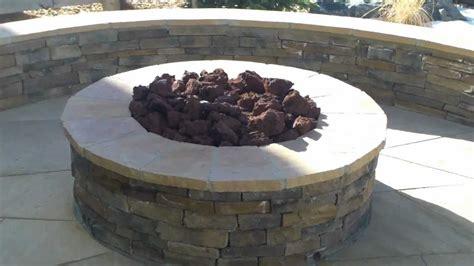 pits denver denver landscape contractor installing flagstone patio