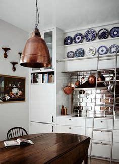 kitchen pendant lights and mirrored tile splashback home the art of the beautiful backsplash 25 kitchen