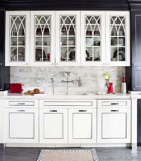 white kitchen cabinets with gothic arch glass front doors