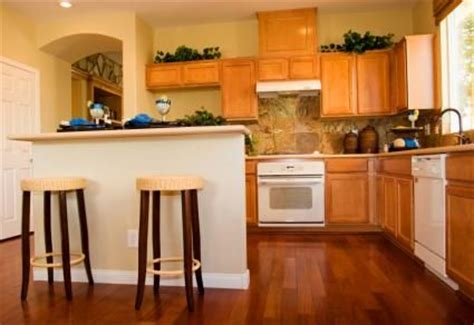 coordinating wood floor with wood cabinets cabinets that match cherry floors