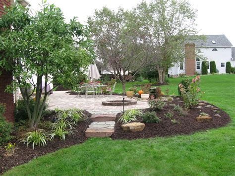 Landscaping Around Patios Pictures by Klein S Lawn Landscaping Landscapes Designed Landscapes