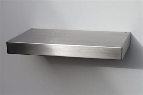 small rectangular stainless steel floating shelf of