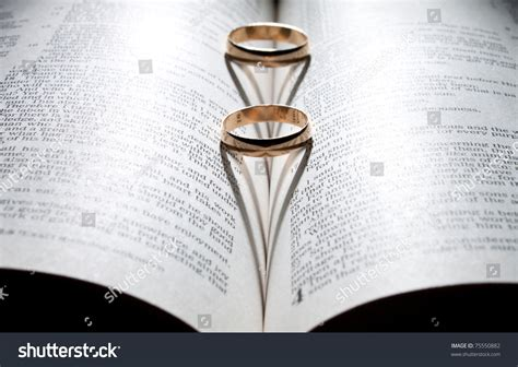 Wedding Bible Pictures by Wedding Rings On Bible Shadow Shape Stock Photo 75550882