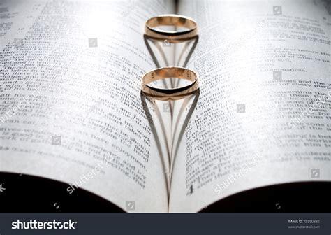 wedding bible pictures wedding rings on bible shadow shape stock photo 75550882