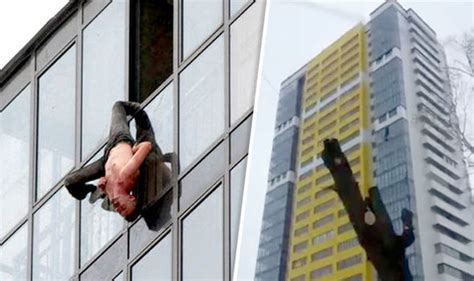 fenster stuck hanging from 15ft floor window rescued after getting