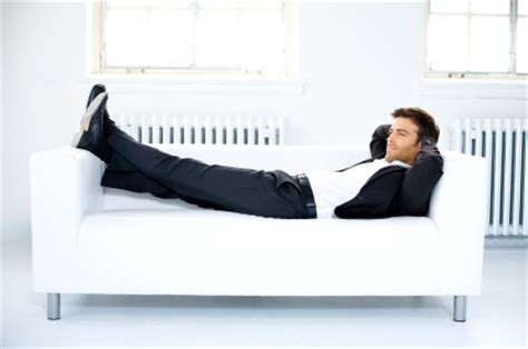 man on sofa get out of your comfort zone the way consulting