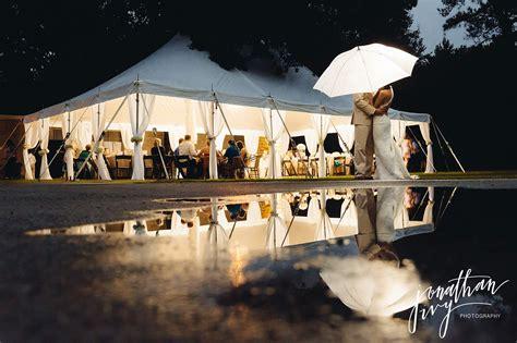 wedding in tented outdoor rainy day wedding the garner wedding