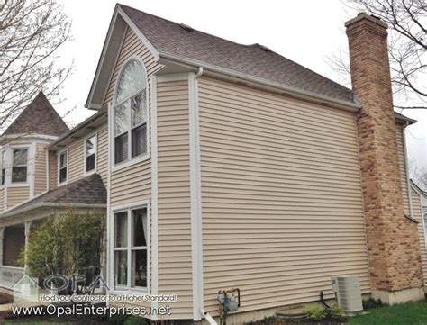alside vinyl siding in vintage wicker with white trim and white windows traditional