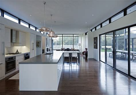 modern kitchen with white cabinets large sliding doors