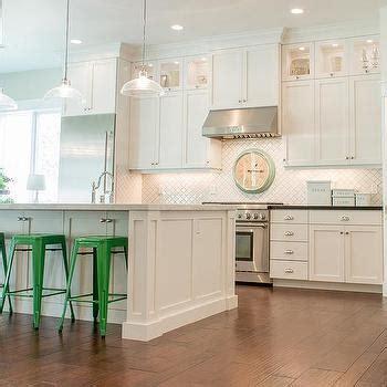 pale aqua pantry door white shaker cabinets black merola tile arabesque matte white transitional kitchen