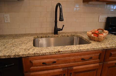 ceramic subway tile kitchen backsplash kitchen subway tile brown cabinets appealing