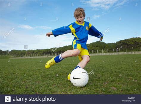 Kicking The boy kicking football stock photo royalty free image