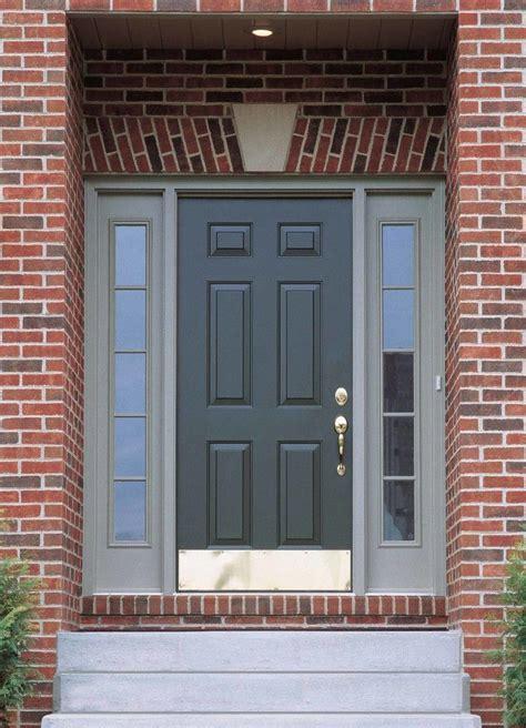 dark grey wooden door connected  double glass windows