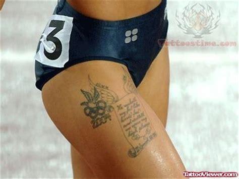 heartbeat running tattoo olympic logo and scroll tattoo on right thigh tattoo