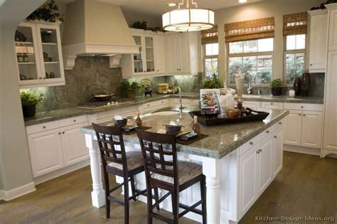 kitchen of the day traditional white cabinets pair nicely with wood floors and light green