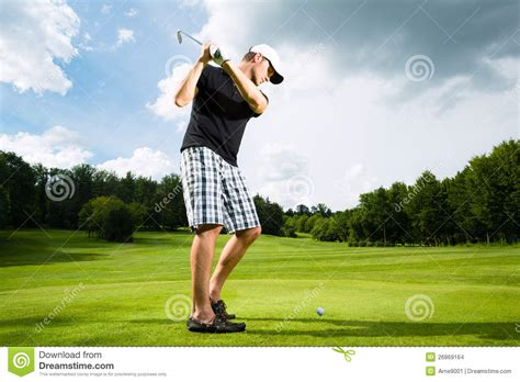 swing player young golf player on course doing golf swing stock photo