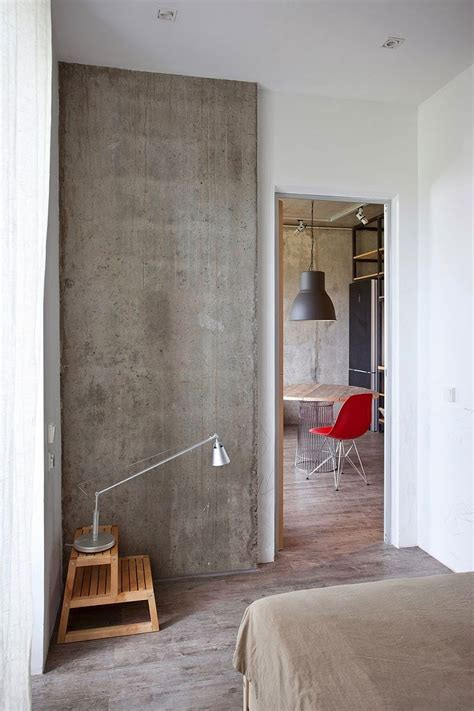 exposed concrete walls small modern industrial apartment draped in metal wood and brick