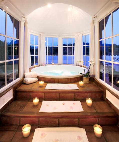 bathtub with steps jacuzzi bathtub with candled steps and round windows a interior design