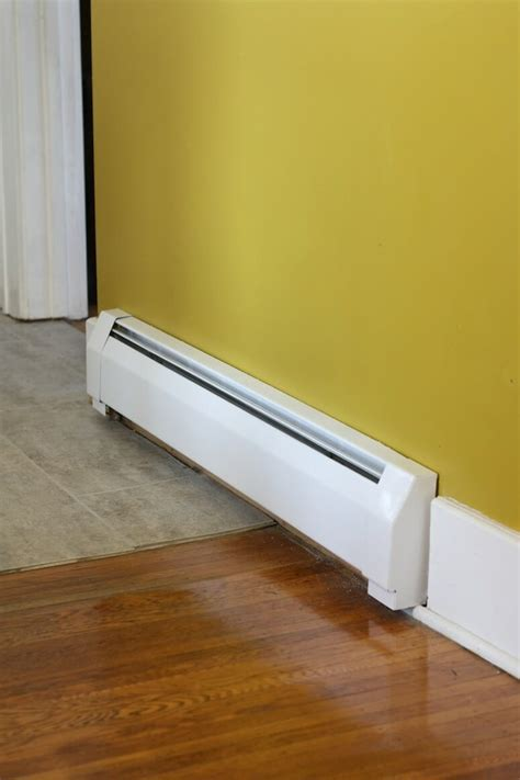 hiw well does wood floor conduct radiant heat a baseboard radiator inside a home
