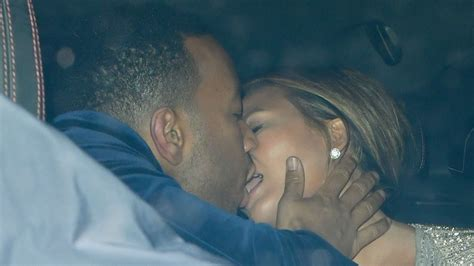 chrissy teigen shares  passionate kiss  john legend
