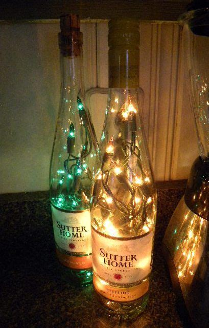 2 lighted wine bottles sutters home moscato and reisling