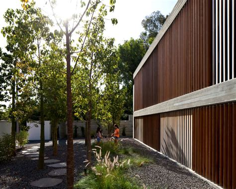 Concrete House With Wood Louvered Panel System InteriorZine