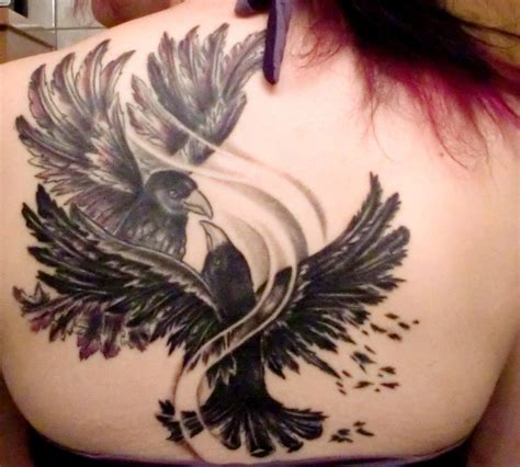 fighting tattoos black ink two crows fighting on back