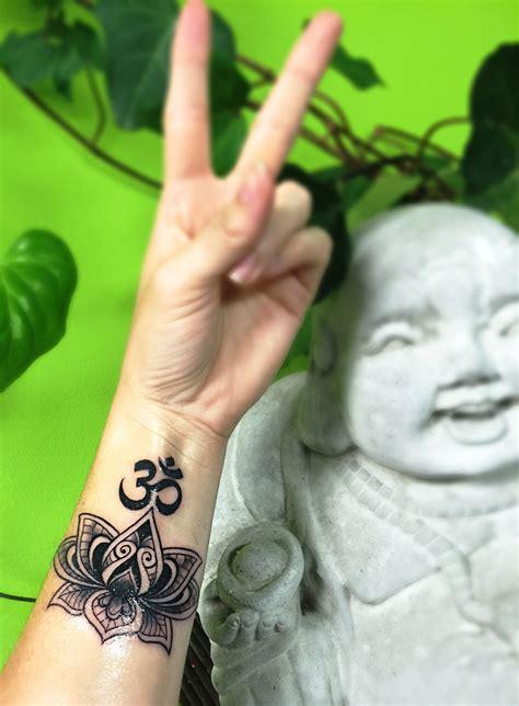 ohm wrist tattoo lotus mandala wrist artist bunde mecca