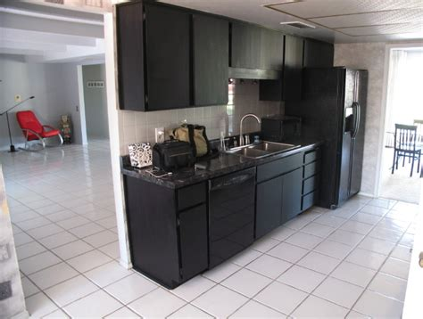 kitchen design with black appliances kitchen design black appliances with red chair black
