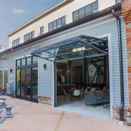 glass garage door houston hydraulic bi fold glass garage door by crown inc