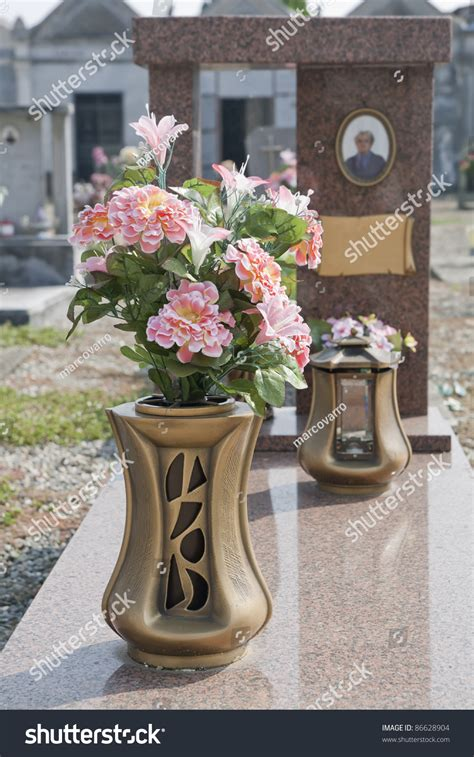 colorful silk flower vase in a cemetery stock photo