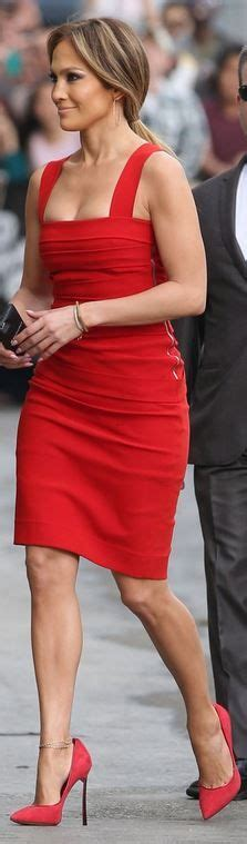 jennifer comfortable who made jennifer lopez s red pleated dress and spike