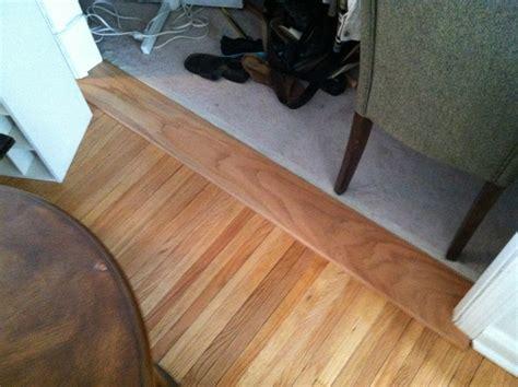 custom red oak transition between carpet and hardwood