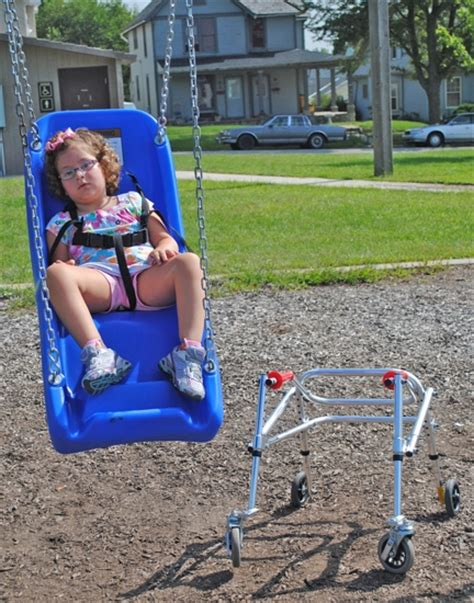 swings for children with special needs children with physical disabilities can now enjoy 2