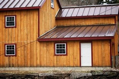houses with board and batten siding board and batten siding trim in contrasting color that compliments metal roof color