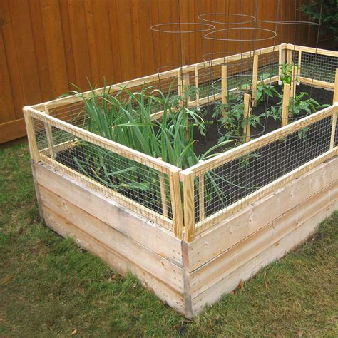 raised garden bed with fence 12 diy raised garden bed ideas