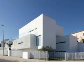 Minimalist white house with plain surface by jorge mealha home