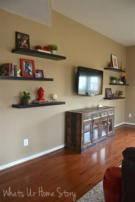 how to decorate floating shelves how to decorate around a tv with floating shelves whats