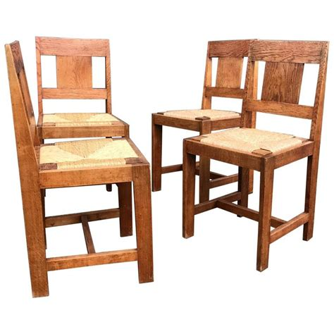 early 1900s set of four arts and crafts dining chairs