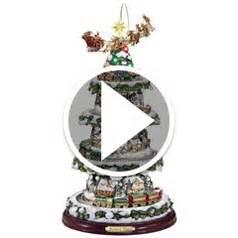 the thomas kinkade animated christmas tree hammacher