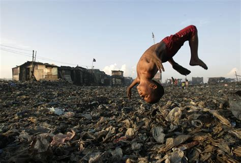 living on the in world s poorest slums landfills and polluted rivers become a child s playground pbs newshour