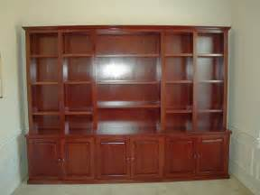 custom made solid cherry bookcase with bottom cabinets