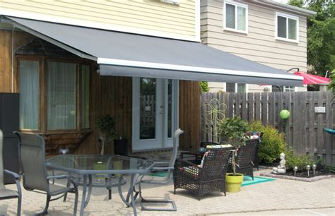 solid awnings solid grey awning by the pool side rolltec 174 retractable