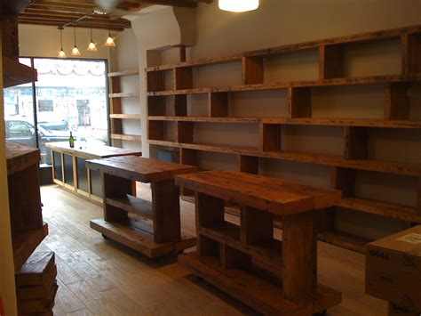 woodworking retail stores wood shelving up the wall pos counter reclaimed wood top