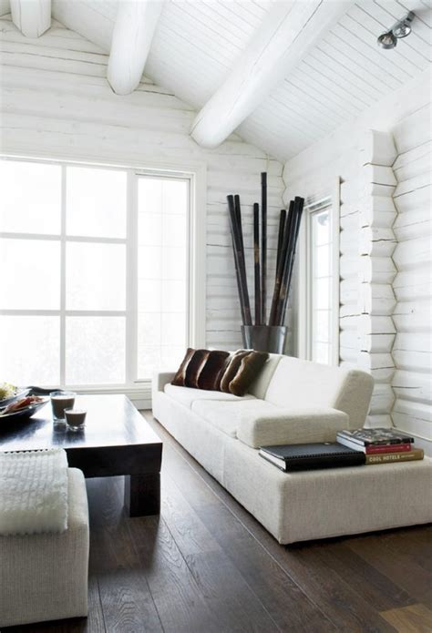 artistic painting interior walls of log cabin using white