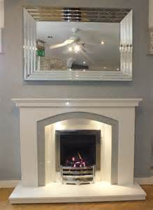 grey fireplace dovetail arch white grey marble fireplace with lights