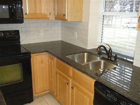 kitchen backsplash subway tile black granite countertop